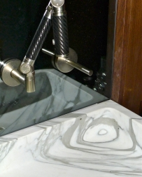 This is a spectacular sink shaped out of a large block of a Statuario class marble.
